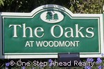sign for The Oaks